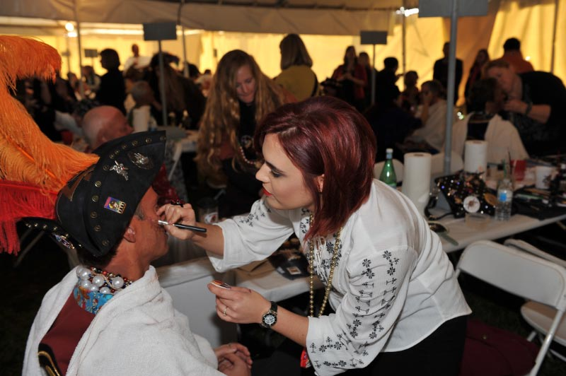 Christina Lumsford working on a pirate doing the makeup
